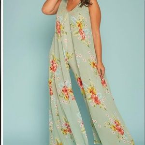 Caped jumpsuit perfect for vacation.NWOT